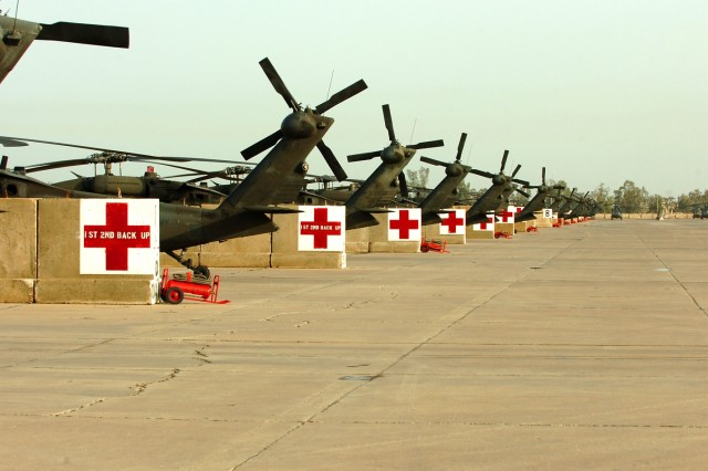 Medical evacuation UH-60 Black Hawk helicopters sit on the airfield at Camp Taji, Iraq. The MEDEVAC Soldiers from Company C, 2nd Battalion, 227th Aviation Regiment, 1st Air Cavalry Brigade, 1st Cavalry Division, transferred authority of the MEDEVAC mission for the Baghdad area to Company C, 2nd Battalion, 3rd Aviation Regiment, 3rd Infantry Division.