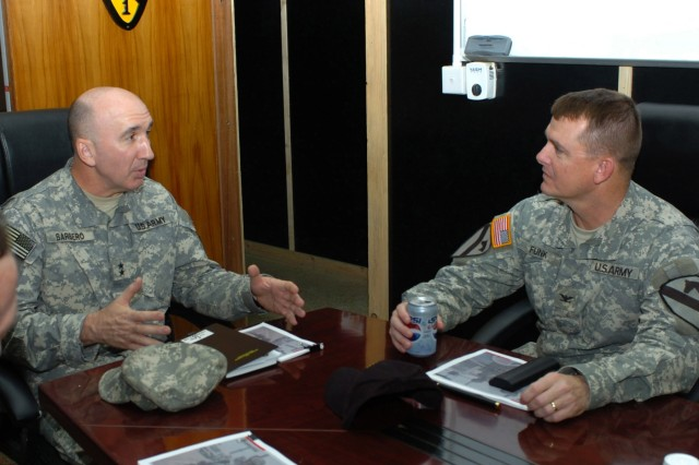 "Maj. Gen. Michael D. Barbero (left), the general in charge of strategic operations for Multi-National Force-Iraq, takes time to speak with Roundup, Mont., native, Col. Paul E. Funk II, commander, 1st ""Ironhorse"" Brigade Combat Team, 1st Cavalry Division, about security improvements, reconciliation efforts and the way ahead in the Ironhorse Brigade's area of operations during his visit to Camp Taji, Iraq Nov. 7. Prior to meeting with Funk, Barbero's visit to the base camp also included a stop at the Counterinsurgency Center for Excellence."
