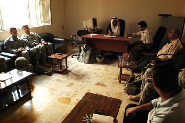 Members of the 1st Battalion, 5th Cavalry Regiment, a Fort Hood, Texas-based unit operating in western Baghdad attached to the 2nd Brigade Combat Team, 1st Infantry Division, discuss the future of the Ameriyah region of the Mansour District with local council members Nov. 8 at the council's headquarters.