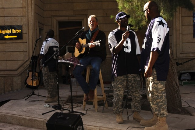 """Staff Sgt. Jammie Blunt (center) and Pfc. Alphonso Izzard (right), perform with """"The Singing Cowboy,"""" Freddie Fuller, during a show for Soldiers of the 2nd Brigade Combat Team, 1st Cavalry Division at Forward Operating Base Prosperity in central Baghdad Nov. 10. Fuller, a native of Saledo, Texas, is currently in Baghdad on a tour to entertain the troops."""
