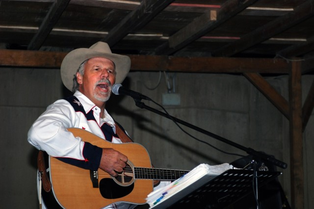 """Freddie Fuller, the """"Singing Cowboy,"""" performs for Soldiers at the Pegasus Dining Facility at Camp Liberty in western Baghdad Nov. 12. Fuller, a Salado, Texas native, made a seven-day visit to Iraq, bringing 1st Cavalry Division Soldiers throughout Multi-National Division - Baghdad a taste of Texas as he performed and told stories."""