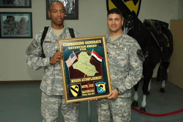 Lancaster, S.C. native, Command Sgt. Maj. Jeffery A. Moses (left), the senior noncommissioned officer of the 1st Cav. Div. Special Troops Battalion, and Long Island, N.Y. native, Lt. Col. Daniel Garcia, commander of the DSTB, hold the Commanding General's Award for meeting and exceeding their retention goals for fiscal year 2007.