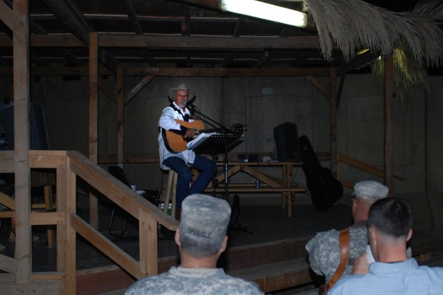 "Soldiers listen in as Salado, Texas native, Freddie Fuller performs at the Pegasus Dining Facility at Camp Liberty in western Baghdad, Nov. 12. Fuller, who calls himself the ""Singing Cowboy,"" performed the last of his seven-concert tour outside the 1st Cavalry Division's dining facility. """