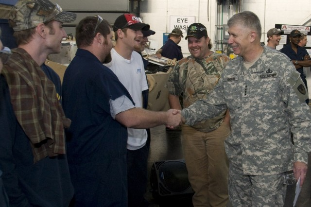 After the Shingo medallion presentation on the FAASV assembly line, AMC Commanding General Gen. Benjamin Griffin congratulates many of the employees who work daily to remanufacturing combat vehicles in support of the men and women in uniform.  Shown here are (l to r) Joe Mitchell, Chad Phillips, Joe Sutherlin, and Richard Rollins.