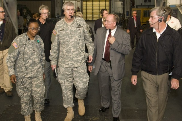 AMC Commanding General Gen. Benjamin Griffin visited Anniston Army Depot on Nov. 14.  One of his stops included Bldg. 400, the Combat Vehicle Assembly and Disassembly facility.  Pictured here (from l to r) are Col. S. B. Keller, depot commander; Jack Cline, deputy to the commander; and Jackie George, director of production.