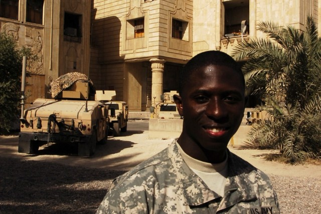 Spc. Emmanuel Danso, a supply clerk with Company E, 1st Battalion, 5th Cavalry Regiment, which is currently attached to the 4th Squadron, 9th Cavalry Regiment, 2nd Brigade Combat Team, 1st Cavalry Division, poses in front of the palace at Forward Operating Base Prosperity in central Baghdad Nov. 10. Danso recently received a scholarship for the Army's Green to Gold program, and will begin attending classes at Liberty University in Lynchburg, Va. next fall.