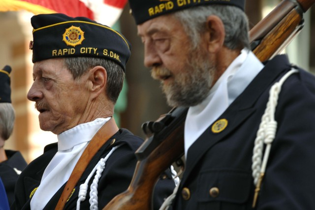 Members of the South Dakota American Legion march in the parade.