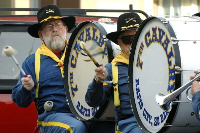 Reenactors of the 7th Cavalry Drum and Bugle Corps perform in the parade.
