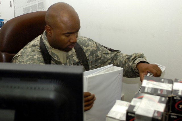 Philadelphia native, Spc. Jermaine Lawson, supply clerk with Company C, 2nd Battalion, 5th Cavalry Regiment packs up binders to send back home, Nov. 5 at Camp Liberty in western Baghdad. Lawson's company is attached to the 1st Cavalry Division Special Troops Battalion, which is preparing for redeployment in December.