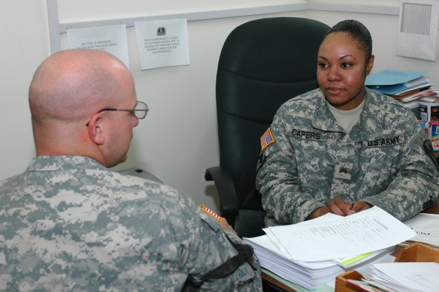 "Sgt. Janeice Capers, (right), a Property Book Office clerk for 1st Air Cavalry Brigade, 1st Cavalry Division, speaks with Denton, Texas, native Sgt. Austin Sweet, 1st ""Attack"" Battalion, 227th Aviation Regiment, 1st ACB, Nov. 17 at Camp Taji, Iraq. Capers joined the Army in May 2001 and graduated from her advanced individual training course two days after the attacks of Sept. 11, 2001. She has deployed to Iraq three times since February 2003."