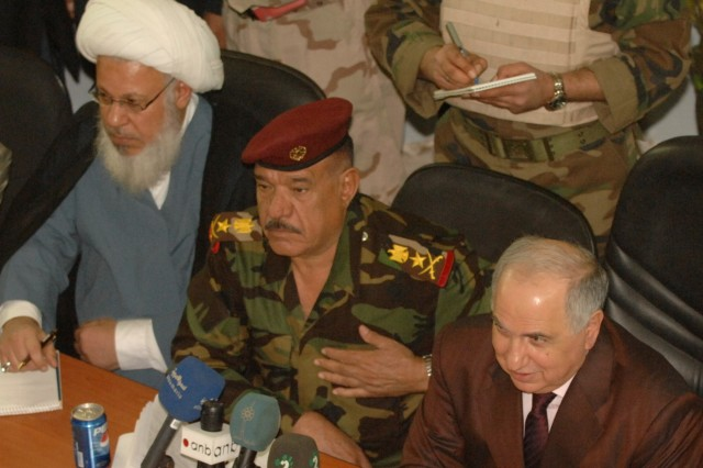 Sheik Hassan Al Sudany (left), a representative for Grand Ayatollah Sistani; Iraqi Army Lt. Gen. Abud Qanbar (center), commander, Baghdad Operations Command, and Dr. Ahmed Challabi, Operation Fahrd Al Qanoon services committee chairman address questions about essential services from local concerned citizens in a town hall-type meeting in the city of Sab Al Bor, Iraq Nov.