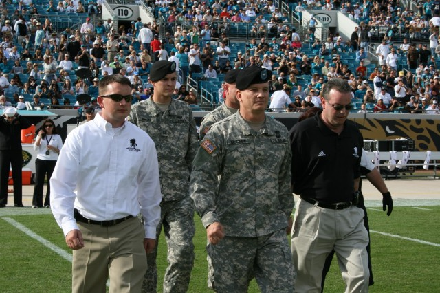 SSG Ryan Kelly, The Wounded Warrior Project, BG Rick McCabe, Commanding General of the White Sands Missile Range and John Roberts of The Wounded Warrior Project move to mid-field to administer the oath of enlistment to more than 100 military recruits during the Jacksonville Jaguars Military Apprecation Day game versus the San Diego Chargers on November 18, 2007.