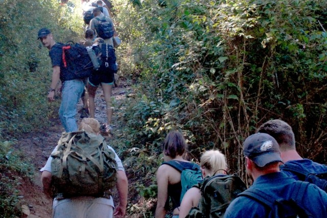 Soldiers from Joint Task Force Bravo at Soto Cano Air Base, Honduras, traverse a steep trail to deliver food to a local village at La Sampedrana.