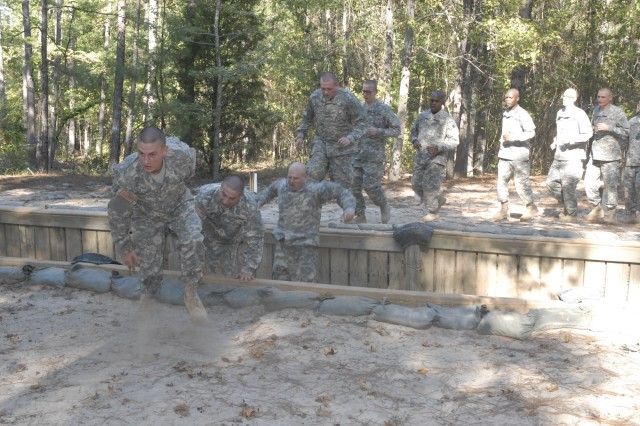 Basic Combat Training Soldiers assigned to Company C, 2nd Battalion, 13th Infantry Regiment tackle the trench jump Thursday at the Fit to Win Course I. The Soldiers were taken to the course right after departing the 120th Adjutant General Battalion (Reception).