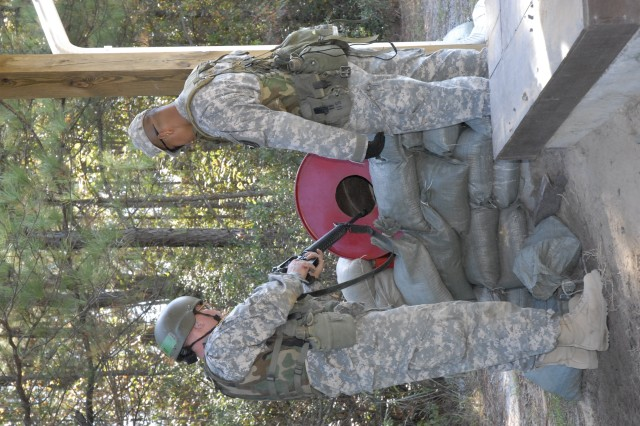 Pfc. Gregory Snow clears his weapon Nov. 1 at Lomah Range under the watchful eye of Staff Sgt. Khemmony Kong, both with Company C, 2nd Bn., 13th Inf. Reg.