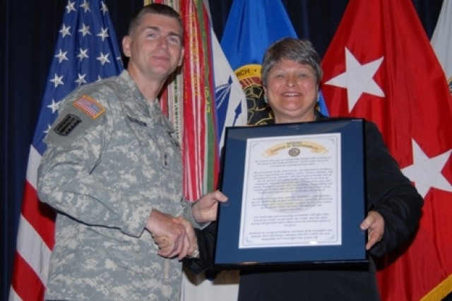 Dr. Marilyn M. Freeman, director, U.S. Army Natick Soldier Research, Development and Engineering Center, is presented the NSRDEC charter by Maj. Gen. Fred D. Robinson Jr., commander, U.S. Army Research, Development and Engineering Command, during her Assumption of Responsibility ceremony.