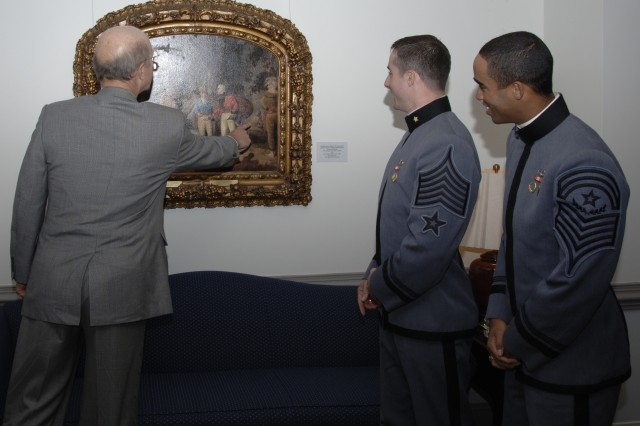 Secretary of the Army Pete Geren shows U.S. Military Academy officers and cadets military artifacts and artwork he has displayed throughout his office, Oct. 31.