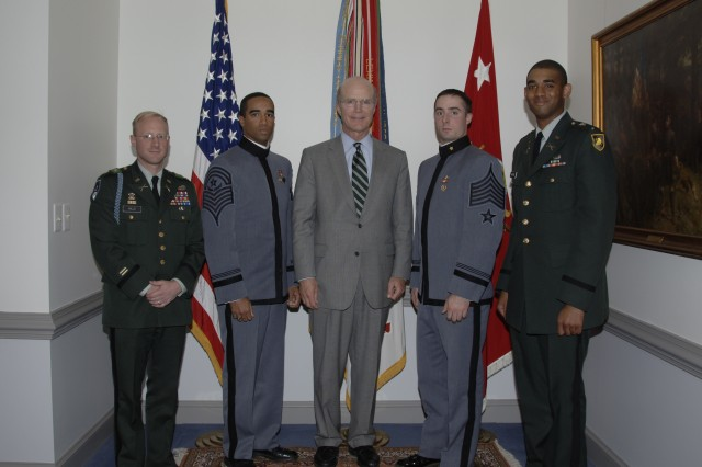 Secretary of the Army Pete Geren takes a group photo with U.S. Military Academy officers and cadets after unveiling military artifacts and artwork reflecting the Army values which he has displayed throughout his office, Oct. 31.