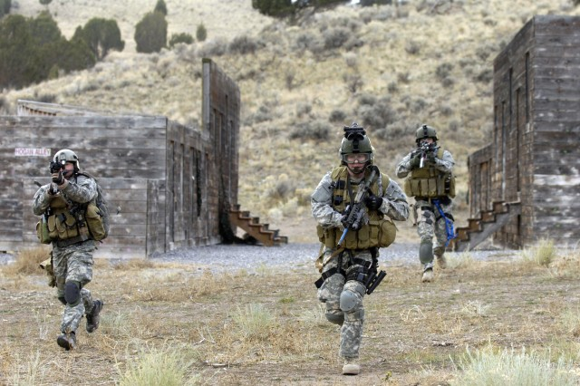 Soldiers conduct an urban village assault.