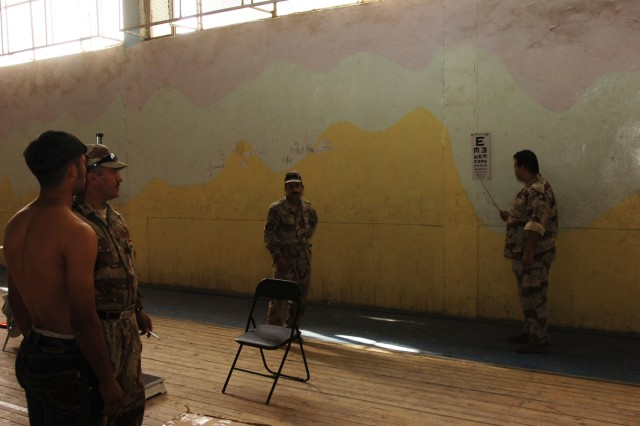 A potential Iraqi police recruit is given an eye test during the medical assessment portion of a police recruitment drive, which was held in Karkh Nov. 16.