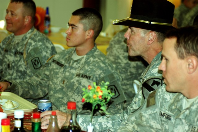 Maj. Gen. Joseph Fil, 1st Cavalry Division and Multi-National Division - Baghdad commanding general, talks with Soldiers over Thanksgiving dinner at a dining facility on Camp Taji, Iraq Nov 22. Fil spent Thanksgiving visiting Soldiers throughout the MND-B area of operations and was able to thank many Soldiers face-to-face for all the hard work they have done over the past year.