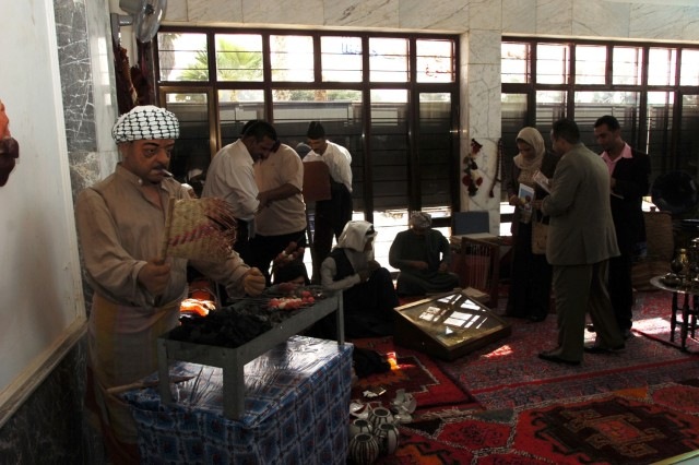 Baghdad residents check out a historical display during the Baghdad Day celebration, which was held in Zawra Park, Nov. 17.