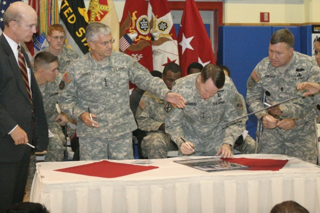 Secretary of the Army Pete Geren and Chief of Staff of the Army Gen. George Casey sign the Army Family Covenant in a ceremony at West Point, N.Y., Oct. 30.
