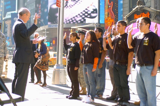 Secretary of the Army Pete Geren administers the oath of enlistment to new recruits during a ceremony outside the Times Square Recruiting Station in New York, Oct. 31.