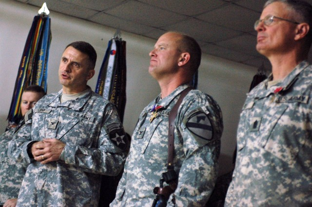 """Col. John Lehr, commander of the 4th Stryker Brigade Combat Team, 2nd Infantry Division, and incoming commander of Diyala province, speaks during the Nov. 27 color casing ceremony for the outgoing 3rd Brigade Combat Team, 1st Cavalry Division, at Forward Operating Base Warhorse in Baqouba, Iraq. The """"Grey Wolf"""" brigade, commanded by Col. David W. Sutherland and Command Sgt. Maj. Donald R. Felt, is in the process of redeploying after a 14-month deployment in support of Operation Iraqi Freedom 06-08."""