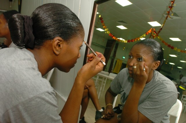 Sgt. 1st Class DaShawn Jefferson, Headquarters and Headquarters Company, 2nd Brigade Combat Team, 1st Cavalry Division, applies her make-up before the Black Jack Runway performance at the Black Jack Bistro Dining Facility at Forward Operating Base Prosperity in central Baghdad, Nov. 22.