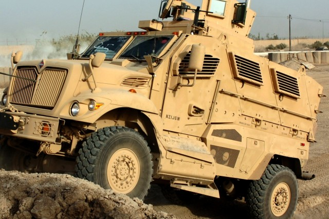 Soldiers from Company B, 1-30th Infantry Regiment, 2nd Brigade Combat Team, 3rd Infantry Division, drive a new mine-resistant, ambush-protected vehicle, or MRAP, through an off-road confidence course at Camp Liberty, Iraq, Nov. 7, 2007.