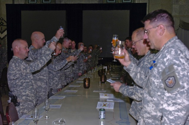 Soldiers of the 1st Cavalry Division and the 138th Fires Brigade, Kentucky Army National Guard, toast to the United States of America as part of the traditional St. Barbara induction ceremony in the Al-Faw Palace at Camp Victory in western Baghdad, Nov. 23. More than 130 Soldiers and guests attended the ceremony, where 21 new members were inducted into the Order of St. Barbara.