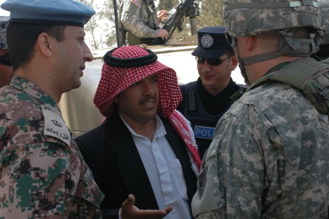 Soldiers negotiate with a local imam (religious leader) while on a practice mounted patrol during a cultural-awareness situational-training exercise.