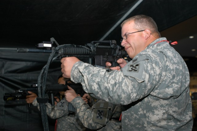 Staff Sgt. Scott Zeman responds to a sniper's ambush at the Interservice/Industry Training, Simulation and Education Conference Nov. 26. The ambush was part of a simulator training scenario Staff Sgt. Zeman and two other Soldiers participated in.