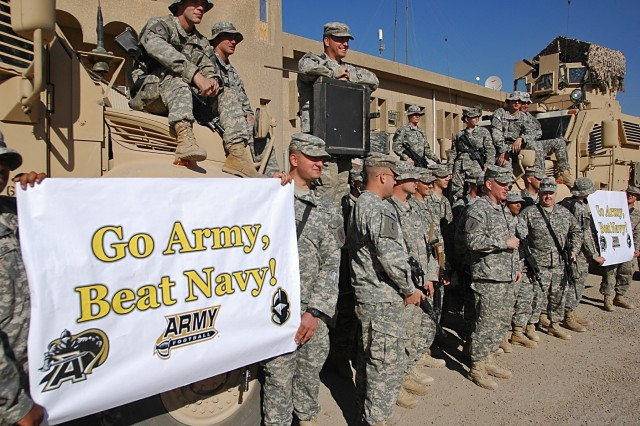 "Col. Ricky D. Gibbs, commander of the 4th Infantry Brigade Combat Team, 1st Inf. Div., and other Dragon Brigade Soldiers show their support for the ""Black Knights"" of the U.S. Military Academy at West Point by shouting out, ""Go Army Beat Navy!"" at Forward Operating Base Falcon in southern Baghdad, Nov. 25."