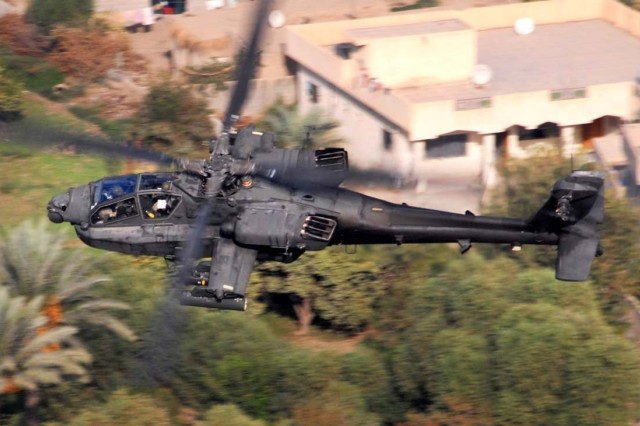 """An AH-64D Apache helicopter flies Baghdad. The crew, from Company B, 1st """"Attack"""" Battalion, 227th Aviation Regiment, 1st Air Cavalry Brigade, 1st Cavalry Division, is looking for enemy mortar and anti-aircraft systems."""