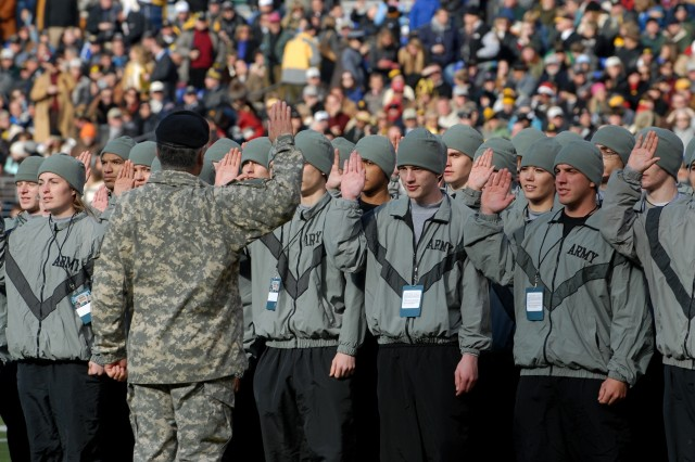 Fifty new Soldiers take the oath of enlistment during a break in the 108th annual Army Navy football game in Baltimore, Md. Dec 1, 2007.