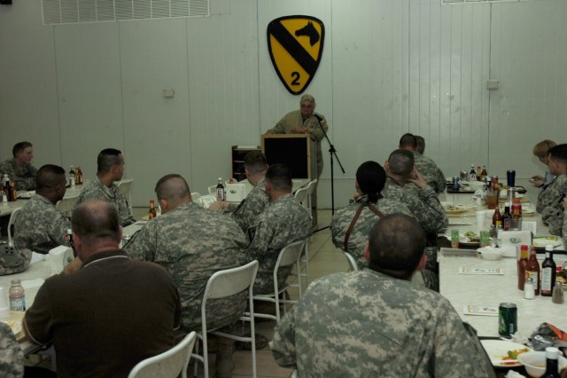 Soldiers from the 2nd Brigade Combat Team, 1st Cavalry Division  listen to  Dave Roever, a Vietnam veteran and internationally renowned motivational and inspirational speaker during a prayer luncheon at Forward Operating Base Prosperity's Black Jack Bistro in central Baghdad Nov. 27.""