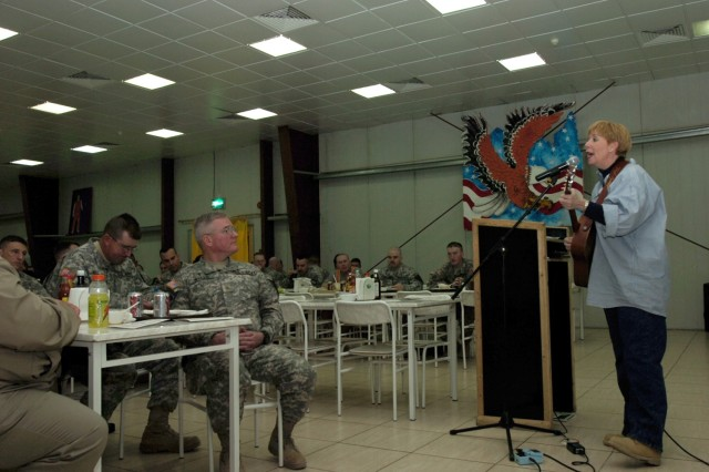 Betsy Brown, the founder of Heartsong Ministries, a non-profit organization in Texas, sings for Soldiers of the 2nd Brigade Combat Team, 1st Cavalry Division at Forward Operating Base Prosperity's Black Jack Bistro in central Baghdad during a prayer luncheon Nov. 27.""