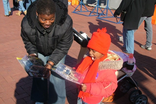 Baltimore's Carlita Nelson, left, and 4-year-old Daveona Nelson think getting a free action figure is a real scream. ""