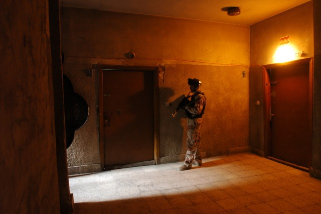 An Iraqi Army soldier secures a floor of an apartment building during Operation Saber Sweep in Baghdad's Karkh District.