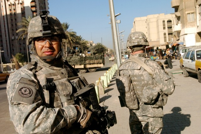 Orlando, Fla., native Sgt. Tamayo Gonzalez, Troop O, 4th Squadron, 2nd Stryker Cavalry Regiment, keeps an eye out during clearing operations in Baghdad's Karkh District.