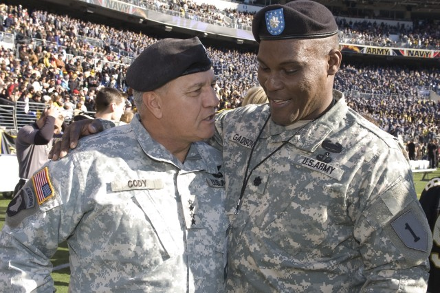 Gen. Richard Cody, vice chief of staff of the Army greets Lt. Col. Greg Gadson, a former West Point football player who lost both legs to an improvised-explosive devise in Baghdad, at the 108th Army-Navy football game in Baltimore Dec. 1. Players and fans recognized America's wounded and fallen warriors during the game.