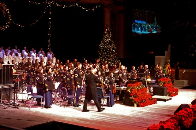 """Col. Thomas Rotondi Jr. greets concertmaster Master Sgt. Laura Knudson as he takes the stage for the Army Band's """"A Holiday Festival"""" concert Dec. 8 at DAR Constitution Hall in Washington, D.C.  Over 12,000 came for the four performances of the show, three of the shows with turnaway crowds."""