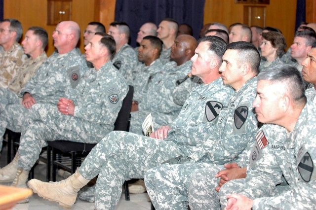 Commanders and senior noncommissioned officers from Multi-National Division - Baghdad, Multi-National Corps - Iraq and Multi-National Force - Iraq, attend a memorial service in the Division Chapel at Camp Liberty in western Baghdad which honored all MND-B Soldiers who gave their lives during the 1st Cavalry Division's deployment supporting Operation Iraqi Freedom 06-08, Dec. 7.