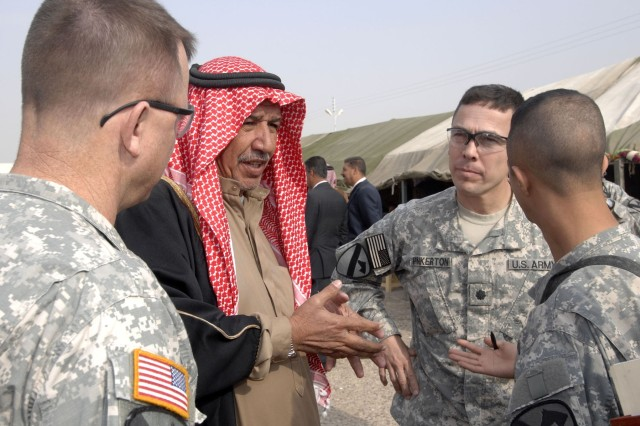 Col. Paul E. Funk II (left), commander of 1st Brigade Combat Team, 1st Cavalry Division discusses the advancements of security in the area with a local tribal leader and Lt. Col. Kurt Pinkerton, commander of 2nd Battalion, 5th Cavalry Regiment during the second installment of the Northwest Baghdad Regional Security Summit held at an Iraqi Police station in Nassir Wa Salam, Iraq, Dec. 6.