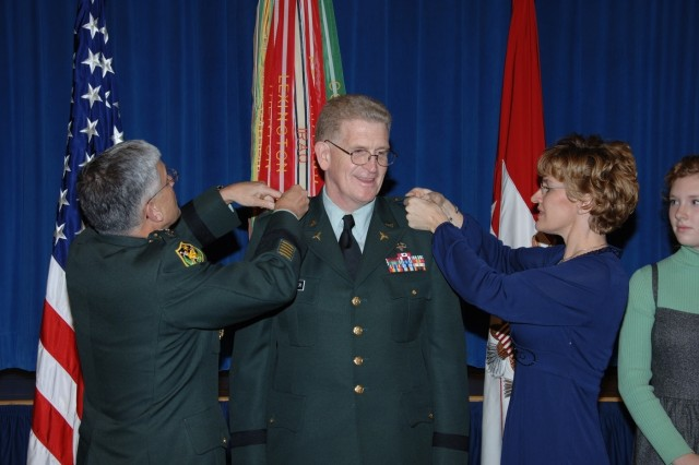 Army Chief of Staff Gen. George W. Casey Jr. and Audrey Schoomaker, wife of the new surgeon general, pin additional stars on his shoulders during his promotion to lieutenant general Tuesday.  Lt. Gen. Schoomaker will be dual-hatted as both surgeon general of the Army and commander of the U.S. Army Medical Command.
