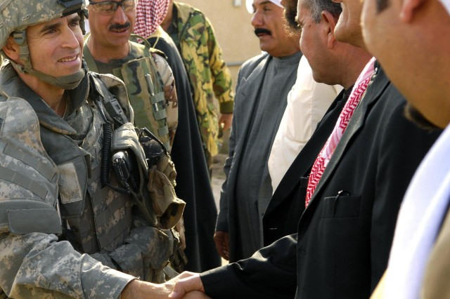 Lt. Col. Christopher Vanek, task force commander of the 1st Brigade Combat Team, 87th Infantry Regiment, 10th Mountain Division, meets with local leaders of Tag Tag, Iraq, to sign a contract to have 5,500 Concerned Local Citizens secure their neighborhoods in coordination with Iraqi security forces and the provincial government.