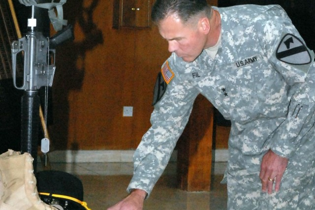 Maj. Gen. Joseph F. Fil Jr., commander, 1st Cavalry Division, speaking at a ceremony in Iraq, honoring the fallen.