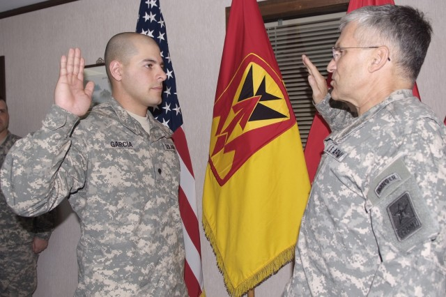 Gen. Casey re-enlists Spc. Garcia